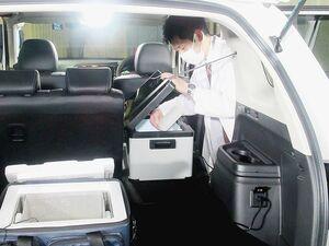 三菱自動車、「アウトランダーPHEV」をワクチン巡回接種車両に活用 冷凍庫に給電