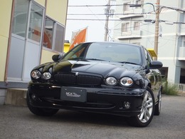 ジャガー Xタイプ 2.5 V6スポーツ 4WD マルチナビ・赤ハーフレザー・パワーシート