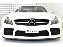 ダイヤモンドホワイト/ブラックナッパAMG Exclusive専用レザーシート、専用5AT、左ハンドル、2009年USモデル 、世界限定350台、2WD、サイドドア以外ドライカーボンボディ