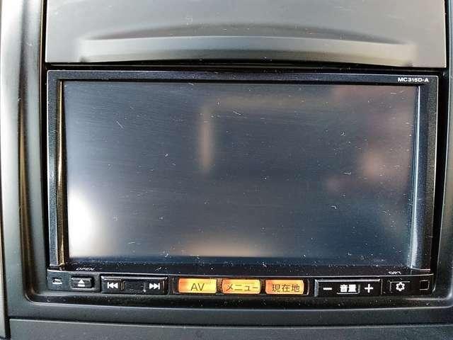 日産純正メメモリーナビMC315D-A。CD/DVD再生、地デジ・チューナー等のオーディオ機能も充実しています。