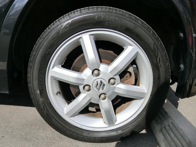 純正15インチAWですタイヤは4分山くらいです。