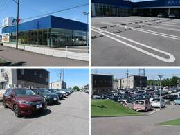 大きなNマークの看板が目印!広々とした駐車場にはお体の不自由な方向け駐車場もございますので、どなた様でも安心してご来場ください。展示場には豊富な在庫をご用意。メーカー問わず比較していただけます。