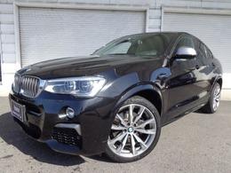 BMW X4 M40i 4WD 左H黒革20AWウッドACC禁煙1オナ認定中古車