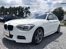 BMW 1シリーズ M135i 買取車・赤革シート・純正ナビ・Bカメラ