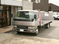 積載車完備で、遠方納車もお任せ下さい。緊急の事故、故障も対応しております。