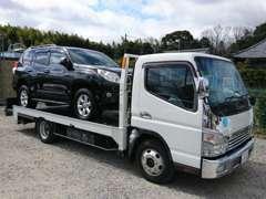 積載車も完備。お車の納車や引き取り、急な故障にも対応できます。