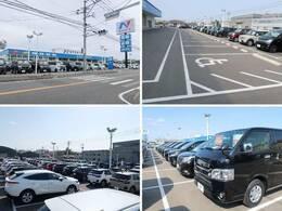 大きなNマークの看板が目印!広々とした駐車場をご用意してお待ちしております。展示場には400台以上のバリエーション豊かな在庫をご用意。メーカー問わず比較していただけます。